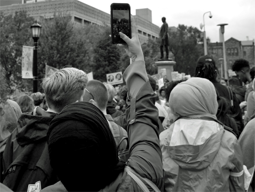 person taking pictures at a rally